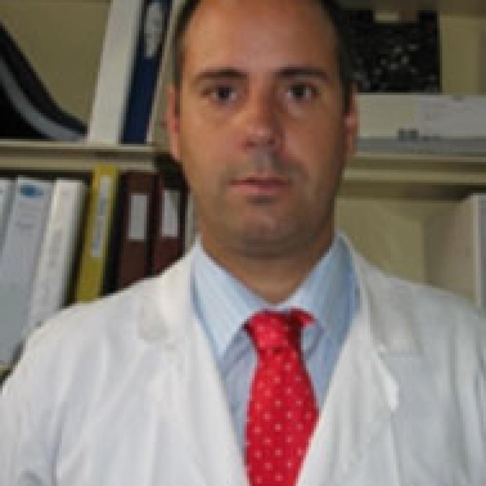 DR    JAVIER  CORTÉS  C.